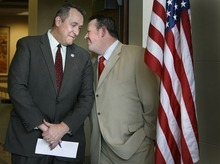 Scott Sommerdorf  |  Tribune file photo  Utah Attorney General Mark Shurtleff, left, talks in February 2010 with Rep. Carl Wimmer, R-Herriman. Despite serious disagreements over immigration laws, Shurtleff this week endorsed Wimmer in the 4th Congressional District race.