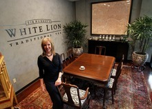 RETRANSMITTING TO REMOVE REFERENCE TO SIR AUBREY IN COMPANY NAME In this photo taken Tuesday, April 3, 2012, Kathryn Petty, President of  White Lion Tea poses at her company's headquarters in Scottsdale, Ariz. (AP Photo/Matt York)