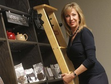 RETRANSMITTING TO REMOVE REFERENCE TO SIR AUBREY IN COMPANY NAME In this photo taken Tuesday, April 3, 2012, Kathryn Petty, President of  White Lion Tea, poses at her company's headquarters in Scottsdale, Ariz. (AP Photo/Matt York)