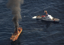 In this photo provided by the U.S. Coast Guard, a plume of smoke rises from a derelict Japanese ship after it was hit by canon fire by a U.S. Coast Guard cutter on Thursday, April 5, 2012, in the Gulf of Alaska. The Coast Guard decided to sink the ship dislodged by last year's tsunami because it was a threat to maritime traffic and could have an environmental impact if it grounded. (AP Photo/U.S. Coast Guard, Petty Officer 2nd Class Charly Hengen)