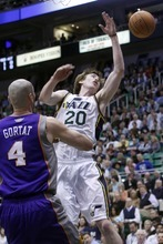 Chris Detrick  |  The Salt Lake Tribune Phoenix Suns center Marcin Gortat (4) guards Utah Jazz shooting guard Gordon Hayward (20) during the first quarter of the game at EnergySolutions Arena Wednesday April 4, 2012. Utah is winning the game 24-21.