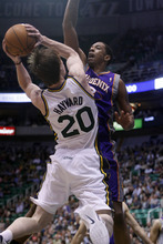 Chris Detrick  |  The Salt Lake Tribune Utah Jazz shooting guard Gordon Hayward (20) is guarded by Phoenix Suns center Channing Frye (8) during the first quarter of the game at EnergySolutions Arena Wednesday April 4, 2012. Utah is winning the game 24-21.