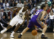 Chris Detrick  |  The Salt Lake Tribune Utah Jazz power forward Paul Millsap (24) steals the ball from Phoenix Suns point guard Steve Nash (13) during the second half of the game at EnergySolutions Arena Wednesday April 4, 2012. Phoenix won the game 107-105.