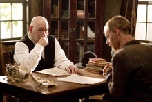 The graverobber Jean Baptiste (David H. Stevens, right) faces Judge Smith (Barry Corbin) in a scene from the Utah-made drama