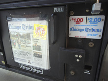 Tim Boyle     Bloomberg News The success with pay walls has prompted others to follow suit, including some of Lee Enterprises Inc.'s 52 newspapers, and some of Tribune Co.'s 12 newspapers, which include the Los Angeles Times and the Chicago Tribune.