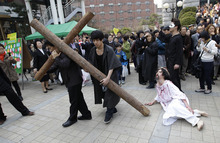 South Korean Christian devotees reenact  the crucifixion of Jesus Christ during a performance for the Easter in Seoul, South Korea, Sunday, April 8, 2012.  (AP Photo/Lee Jin-man)