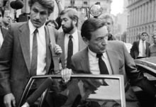 FILE - In this Oct. 15, 1984 file photo, CBS-TV Correspondent Mike Wallace, right, and producer George Crile, left, leave U.S. District Court in New York, after attending the trial of a libel suit brought by former Gen. William C. Westmoreland against CBS -TV. Wallace, the dogged, merciless reporter and interviewer who took on politicians, celebrities and other public figures in a 60-year career highlighted by the on-air confrontations that helped make