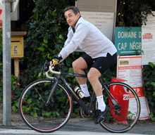 France's President and candidate for the Presidential Election 2012, rides his bicycle in Cavaliere, French Riviera, Sunday, April 8, 2012. Sarkozy and his wife, Carla Bruni-Sarkozy, are spending their Easter week-end at his mother-in-law's property in Cap Negre . (AP Photo/Claude Paris)