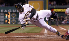 Pittsburgh Pirates' Josh Harrison twirls to the ground after being hit by a pitch from Philadelphia Phillies' Joe Blanton in the 10th inning of the baseball game on Saturday, April 7, 2012, in Pittsburgh. The Pirates won  2-1 in 10 innings. (AP Photo/Keith Srakocic)