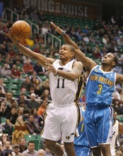 Paul Fraughton  |  The Salt Lake Tribune Utah Jazz point guard Earl Watson (11) takes the shot as New Orleans Hornets point guard Chris Paul (3) defends .The Utah Jazz played the New Orleans Hornets at EnergySolutions Arena on Thursday  March 24, 201.1