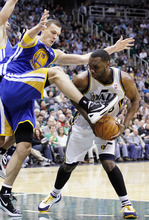 Golden State Warriors center Andris Biedrins, left, of Latvia, fouls Utah Jazz center Al Jefferson (25) during the second half of an NBA basketball game, Friday, April 6, 2012, in Salt Lake City.  Jefferson Scored 30-points in Utah's 104-98 win. (AP Photo/Colin E Braley)