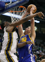 Golden State Warriors power forward David Lee (10) goes up to score against Utah Jazz center Al Jefferson (25) during the first half of an NBA basketball game, Friday, April 6, 2012, in Salt Lake City.  (AP Photo/Colin E Braley)
