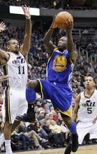 Golden State Warriors point guard Nate Robinson (2) goes up to score against Utah Jazz point guard Earl Watson (11) during the first half of an NBA basketball game, Friday, April 6, 2012, in Salt Lake City.  (AP Photo/Colin E Braley)