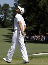 Aaron Baddeley, of Australia, reacts after missing a putt on the second fairway during the fourth round of the Masters golf tournament Sunday, April 8, 2012, in Augusta, Ga. (AP Photo/Matt Slocum)
