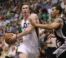 Steve Griffin/The Salt Lake Tribune   Utah's Gordon Hayward drives into the lane during first half action in the Jazz versus Spurs game at EnergySolutions Arena in Salt Lake City Monday April 9, 2012.
