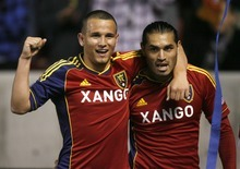 Rick Egan  | The Salt Lake Tribune   Real Salt Lake's Luis Gil (21) celebrates with Real Salt Lake's Fabian Espindola (7) after Espindola scored in the second period, putting Real Salt Lake up 2-0, in RSL action, Real Salt Lake vs. Colorado Rapids at Rio Tinto Stadium, Saturday, April 7, 2012.