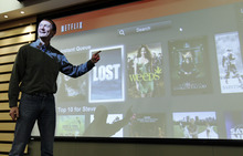 Paul Sakuma   The Associated Press  In this March 20, 2012, photo, Netflix Chief Product Officer Neil Hunt points out popular movies on Netflix at a theater inside Netflix headquarters in Los Gatos, Calif. A big part of Netflix's future rides on how much their engineers can improve the software that draws up lists of TV shows and movies that might appeal to each of the video-subscription service's 26 million customers. Netflix has spent 13 years learning viewers' disparate tastes so it can point out movies they might enjoy.