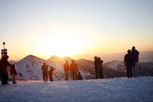 Kim Raff  |  The Salt Lake Tribune People watch the sunrise during an Easter service on top of Hidden Peak at Snowbird Ski Resort on Sunday, April 8, 2012.