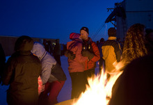 Kim Raff  |  The Salt Lake Tribune People gather around fire pits on Hidden Peak before sunrise for an Easter sunrise service at Snowbird Ski Resort on Sunday, April 8, 2012.