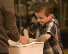 Paul Fraughton | The Salt Lake Tribune Christian Draper, age 8, participates in the symbolic hand-washing at Our Saviour's Lutheran Church's Maundy Thursday observance on April 5, 2012.