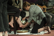 Chris Detrick  |  The Salt Lake Tribune Karen Jackson washes a fellow member's feet during a Maundy Thursday service at Mount Olympus Presbyterian Church on April 5, 2012.