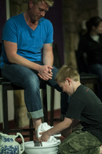 Chris Detrick  |  The Salt Lake Tribune Chase White, 8, washes the feet of his dad, Dave White, during a Maundy Thursday service at Mount Olympus Presbyterian Church on April 5, 2012.