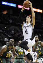 San Antonio Spurs' Danny Green (4) shoots ahead of Utah Jazz's Al Jefferson (25), Paul Millsap (24) and DeMarre Carroll (3) during the second half of an NBA basketball game, Sunday, April 8, 2012, in San Antonio. (AP Photo/Darren Abate)