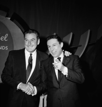 FILE - In this Feb. 12, 1957 file photo, actor Errol Flynn, left, and television host Mike Wallace are shown before NBC's
