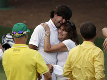 Bubba Watson hugs his mother Mollie after winning the Masters golf tournament following a sudden death playoff on the 10th hole Sunday, April 8, 2012, in Augusta, Ga.(AP Photo/Matt Slocum)
