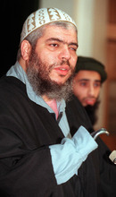 Alastair Grant  |  Associated Press file photo Muslim cleric Abu Hamza al-Masri speaks at a 1999 news conference in London. Britain can extradite the radical cleric and four other suspects to the United States to face terrorism charges, Europe's human rights court ruled Tuesday.