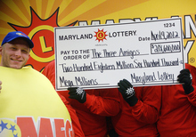 Maryland State Lottery Agency  |  The Associated Press A lottery official, left, and the three anonymous winners of the Maryland portion of the Mega Millions lottery pose Monday for a photo in Baltimore.