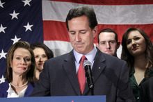 Surrounded by members of his family, former Pennsylvania Sen. Rick Santorum announces he is suspending his candidacy for the presidency Tuesday, April 10, 2012, in Gettysburg, Pa. (AP Photo/Gene J. Puskar)