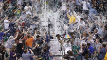 Fan participate in a Silly String fight during the second half of an NBA basketball game between the Utah Jazz and the San Antonio Spurs on Monday, April 9, 2012, in Salt Lake City. The Jazz won 91-84. (AP Photo/Jim Urquhart)