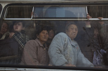 North Korean commuters ride inside a trolly car in Pyongyang, North Korea on Monday, April 9, 2012. (AP Photo/David Guttenfelder)