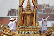 Thai officials pay last respect to the urn of Princess Bejaratana Rajasuda Sirisobhabannavadi before unloading from a carriage to the crematorium during the royal cremation ceremony in Bangkok, Thailand Monday, April 9, 2012. Princess Bejaratana was the only child of King Vajiravudh (Rama VI) and was the first cousin of King Bhumibol Adulyadej, the King of Thailand. The Princess passed away on July 27, 2011 at the age of 86. (AP Photo/Wason Wanichakorn)
