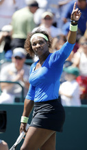 Serena Williams points to the crowd after her match against Samantha Stosur, of Australia, in the semifinals of the Family Circle Cup tennis tournament in Charleston, S.C., Saturday, April 7, 2012.  Williams advanced to the finals by winning 6-1, 6-1.  (AP Photo/Mic Smith)