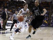 Utah State guard Preston Medlin (13) drives against Hawaii forward Trevor Wiseman (31) during the second half of an NCAA college basketball game, Thursday, Jan. 26, 2012, in Logan, Utah. Utah State won 77-72. (AP Photo/Jim Urquhart)