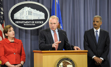 Attorney General Eric Holder, right, and Sharis Pozen, acting assistant attorney general, Antitrust Division, left, listens as Connecticut Attorney General George Jepsen speaks  during a news conference at the Justice Department in Washington, Wednesday, April 11, 2012.  The Justice Department and several states have sued Apple Inc. and major book publishers, alleging a conspiracy to raise the price of electronic books that Attorney General Eric Holder says cost consumers millions of dollars.  (AP Photo/Cliff Owen)