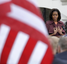 Susan Walsh  |  The Associated Press First lady Michelle Obama speaks Wednesday at a White House event  marking the one year anniversary of Joining Forces.