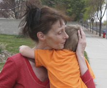 Lennie Mahler  |  The Salt Lake Tribune Sylvia Hartvigsen comforts her grandson Aiden, 3, at the home of Laraine Reid in West Jordan, Tuesday, April 10, 2012. Shantelle Reid, Aiden's mother, was shot and killed Monday, allegedly by 31-year-old Ryan Robinson in Murray.