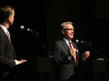 Kim Raff   The Salt Lake Tribune (left) Pete Ashdown listens as Scott Howell answers a question during the Democratic debate for U.S. Senate at Juan Diego Catholic High School auditorium in Draper, Utah on April 11, 2012.
