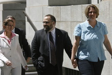 Rick Egan  |  Tribune file photo Rick Koerber and wife Michelle hold hands in 2009 as they leave the Federal Courthouse in Salt Lake City. Koerber divorced his wife that year and married Jewel Skousen, left, an employee of Koerber's Free Capitalist Project.
