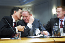 In this June 30, 2011 file photo, comedian Stephen Colbert, left, confers with his attorney Trevor Potter, center, as Matthew Sanderson looks on at right, as they appeared before the Federal Election Committee (FEC) in Washington.  (AP Photo/Cliff Owen, File)