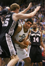 Steve Griffin/The Salt Lake Tribune   Utah's Enes Kanter pushes into San Antonio's Matt Bonner as he looks for room under the basket during first half action in the Jazz versus Spurs game at EnergySolutions Arena in Salt Lake City Monday April 9, 2012.