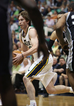 Steve Griffin/The Salt Lake Tribune   Utah's Gordon Hayward cuts across the lane during first half action in the Jazz versus Spurs game at EnergySolutions Arena in Salt Lake City Monday April 9, 2012.
