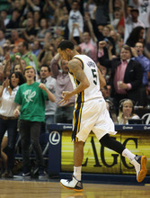 Steve Griffin/The Salt Lake Tribune   Utah's Devin Harris holds out three fingers after nailing a three pointer against the San Antonio Spurs at EnergySolutions Arena in Salt Lake City Monday April 9, 2012. Harris had a huge fourth courter leading the Jazz to victory.