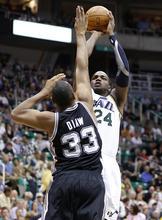 Utah Jazz forward Paul Millsap (24) shoots over San Antonio Spurs forward Boris Diaw (33) during the second half of an NBA basketball game Monday, April 9, 2012, in Salt Lake City. The Jazz won 91-84. (AP Photo/Jim Urquhart)
