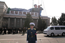 A North Korean traffic policewoman stands on the street near Kim Il Sung Square in Pyongyang, North Korea, Friday, April 13, 2012. North Korean state media acknowledged that the country's satellite failed to enter orbit Friday. The sign reads