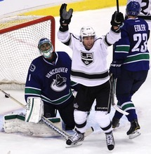 Los Angeles Kings center Jarret Stoll (28) celebrates after teammate Willie Mitchell scored against Vancouver Canucks goalie Roberto Luongo (1) during the second period of Game 1 of an NHL hockey first-round playoff series Wednesday, April 11, 2012, in Vancouver, British Columbia. (AP Photo/The Canadian Press, Jonathan Hayward)