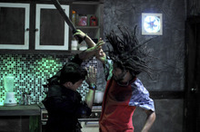 Iko Uwais (left) plays a police officer battling drug henchmen in the Indonesian action film,